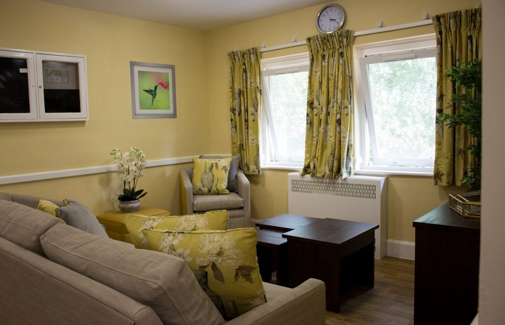 yellow lounge with  soft furnishings